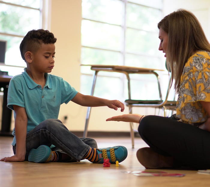 young child working with a counselor